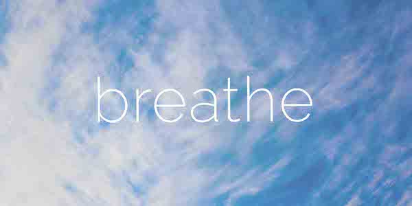 BREATHE: White clouds in a blue sky