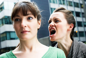 Woman shouting at a woman